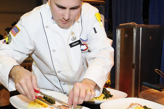 Army Reserve Staff Sgt. Joseph Parker prepares main dish in the contemporary category at the 35th U.S. Army Culinary Arts Competition at Fort Lee, Va. on Friday, March 5, 2010.  Parker prepared butter poached lobster with braised kale, sweet corn spoon bread, lobster & scallop sausage, seafood cracker topped with a lemon butter sauce.  The chefs can choose one of the following items to prepare in the contemporary category:  Rock Cornish Game Hen, chicken or duck; bone-in pork loin, boin-in veal or loin rack, bone-in lamb or rack, game birds, bone-in game, whole rabbit, live lobster or fish. The competition cooking time is 15 minutes for set-up, 60 minutes for cooking, 10 minutes for serving and 15 minutes for clean-up.  Parker, from Haines City, Fla., is assigned to the 841st Combat Engineer Battalion based in Miami, Fla.