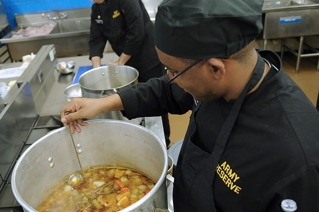 Army Reserve Sgt. Patrick Alveranga, foreground, skims the top of lamb stock in the team's kitchen at the 35th U.S. Army Culinary Arts Competition at Fort Lee, Va. on Wednesday, March 3, 2010.  Alveranga, from Homestead, Fla., is assigned to the 841st Engineer Battalion based in Miami, Fla.