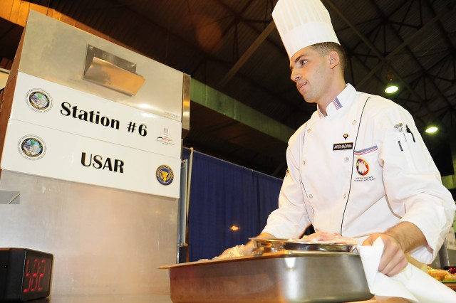 Spc. Daniel Arshadnia prepares his entry in the contemporary category event with a chicken dish at the 35th U.S. Army Culinary Arts Competition at Fort Lee, Va. on Sunday, March 7, 2010.Arshadnia scored the first gold medal for the Army Reserve team preparing a sauteed chicken breast with portobello mushrooms and truffle oil, rissoto, pan steamed asparagus and red pepper coulli.Arshadnia, from Lawrence, N.Y., is assigned to the 841stEngineer Battalion based in Miami, Fla.