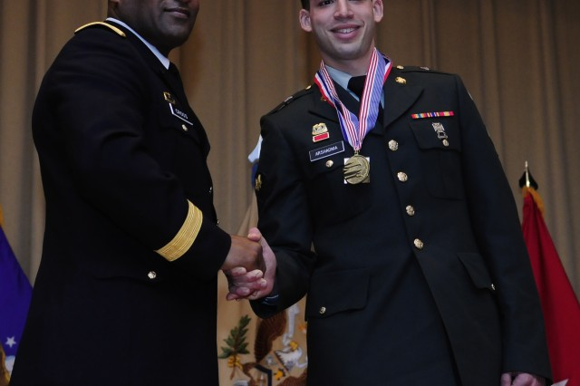 Army Reserve Spc. Daniel Arshadnia, right, shakes hands with Brig. Gen. Jesse R. Cross, Quartermaster General of the Army, at the conclusion of the 35th U.S. Army Culinary Arts Competition at Fort Lee, Va. on Friday, March 12, 2010.Arshadnia is a member of the 841st Engineer Battalion in Miami, Fla.