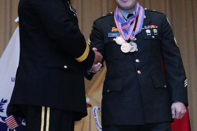 Army Reserve Staff Sgt. Joseph Parker, right, shakes hands with Brig. Gen. Jesse R. Cross, Quartermaster General of the Army, at the conclusion of the 35th U.S. Army Culinary Arts Competition at Fort Lee, Va. on Friday, March 12, 2010.  Parker is a member of the 841st Engineer Battalion in Miami, Fla.