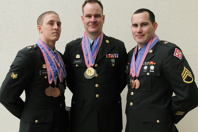 (L-R) Army Reserve Spc. Jeffrey Vaughan, Sgt. Trent Skinner and Staff Sgt. Joseph Parker, were named to the U.S. Army Culinary Arts Team at the conclusion of the 35th U.S. Army Culinary Arts Competition at Fort Lee, Va. on Friday, March 12, 2010.   The USACAT is the U.S. Military National Culinary team which competes in local, national and international culinary competitions to include the Culinary World Cup in Luxembourg and the World Culinary Olympics in Erfurt, Germany.  This is the first time since USACAT was founded in 1984 the Army Reserve has members on the team.  Parker is a member of the 841st Engineer Battalion in Miami, Fla.