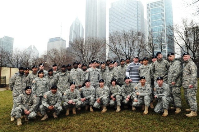 Soldiers from the Chicago Recruiting Battalion, Glenview Recruiting Company, Wounded Heroes Foundation and the 85th Support Command, USAR, gather for a group photo after marching in the 55th Annual Chicago Saint Patrick's Day Parade, on Saturday, 12 March, 2010.
