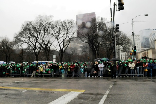 A look at some of the hundreds of thousands of spectators that cheered for the U. S. Army Soldiers along the parade route for the 2010 Chicago Saint Patrick's Day Parade.  The die-hard Irish parade fans showed up in the cold rain and lined up about 16-deep for the celebration on Saturday, 12 March.