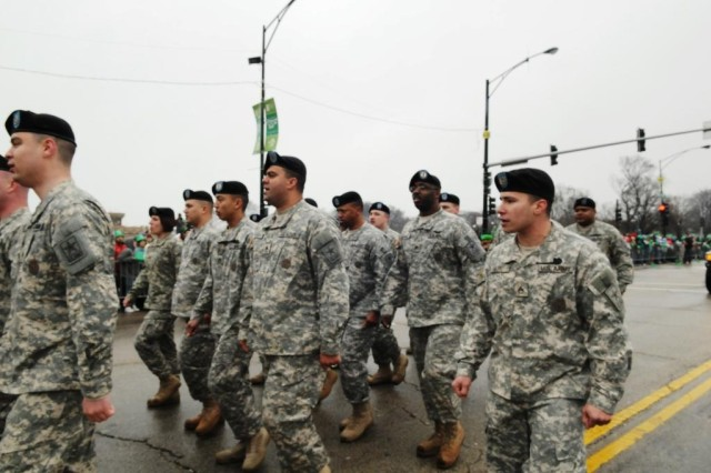 Staff Sgt. Jeremiah Delrio, Glenview IL Recruiting Company, Melrose Park Recruiting Station, leads his fellow Soldiers by calling cadence for them during the 2010 Chicago Saint Patrick's Day Parade on Saturday, 12 March.