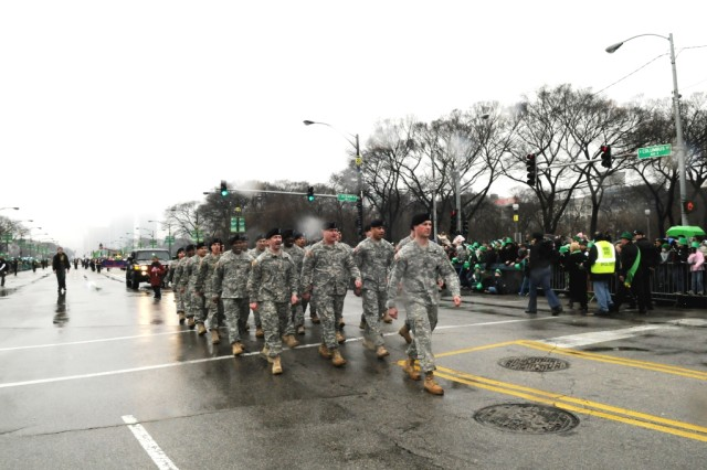 Capt. Peter Gillen, Commander, Glenview Recruiting Company, Chicago Recruiting Battalion, leads his troops down Columbus Street in downtown Chicago for the 55th Annual Saint Patrick's Day Parade.  The Soldiers called cadence while hundreds of thousands of spectators joined in, on Saturday, 12 March, 2010.
