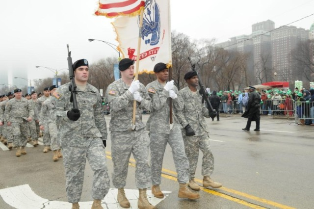 Soldiers from the Chicago Recruiting Battalion, Glenview Recruiting Company, represent the Army with a color guard for the 2010 Saint Patrick's Day Parade on Saturday, 12 March, in front of over 200,000 spectators.  Soldiers from left to right are: Staff Sgt. William Richardson, Staff Sgt. Kenneth Moon, Sgt. 1st Class Kenyada Flowers and Staff Sgt. George Marshbanks.