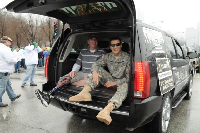 Major A.J. Tong and Spec. Steve Baskis, Wounded Heroes Foundation, participate in the 2010 Saint Patrick's Day Parade on Saturday, 12 March in Chicago, IL, while their names are displayed on the WLS Radio 'WLScalde.'  Both Wounded Warriors, OIF Veterans, are going through the Blind Rehabilitation Program at the Hines VA Hospital, Blind Rehab Center.