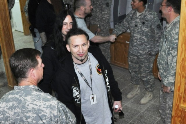 Members of heavy metal band Five Finger Death Punch met with Soldiers from the 15th Sustainment Brigade during the band's visit to Contingency Operating Location Q-West, Iraq, March 5. (U.S. Army photo by Staff Sgt. Rob Strain, 15th Sustainment Brigade Public Affairs)