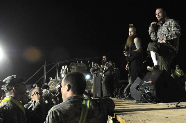 Five Finger Death Punch, a heavy metal band from Los Angeles, performs for service members at Contingency Operating Location Q-West, Iraq, March 5. This tour is the band's first visit to Iraq. (U.S. Army photo by Staff Sgt. Rob Strain, 15th Sustainment Brigade Public Affairs)