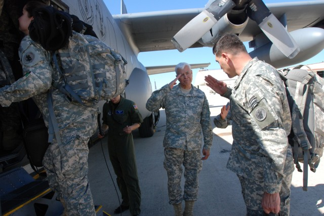 Brig. Gen. Manuel Ortiz (center), U.S. Army South deputy commanding general, salutes Maj. Gen. Simeon G. Trombitas, U.S. Army South commanding general, as Trombitas prepares to board an aircraft to Haiti March 9, in support of Operation Unified Response.