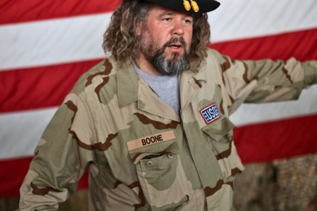 """CAMP TAJI, Iraq - During a town hall meeting with Soldiers from 1st Air Cavalry Brigade, 1st Cavalry Division, U.S. Division-Center, March 15, Mark Boone Jr., an actor in the television show """"Sons of Anarchy,"""" borrows a first sergeant's Stetson to pose for a picture. Four of the actors from the TV show looked at the unit's aircraft, met with Soldiers over lunch and signed autographs."""
