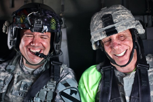 "CAMP TAJI, Iraq - Riding in UH-60 Black Hawk helicopter from 3rd Battalion, 227th Aviation Regiment, 1st Air Cavalry Brigade, 1st Cavalry Division, U.S. Division-Center, March 15, Dayton Callie, an actor in the television show ""Sons of Anarchy,"" gives a nervous reaction to the movement of the aircraft, inciting a hearty laugh from Command Sgt. Maj. Glen Vela, from Dallas, the command sergeant major of the unit. 1st ACB hosted four actors from the TV show, offering Soldiers an opportunity to talk with the actors over lunch and a town hall meeting."