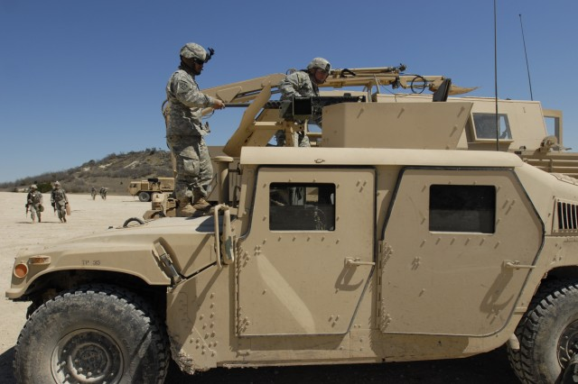FORT HOOD, Texas-Troops assigned to the 4th Brigade Special Troops Battalion, 4th Brigade Combat Team, 1st Cavalry Division mount a .50 caliber machine gun to their humvee in preparation for the battalion's field training exercise, here,  March 12. The training is in preparation for the unit's upcoming deployment to Iraq this fall.