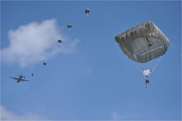 Paratroopers using the Army's new T-11 parachute exit a C-130 March 16, at Fryar Field on Fort Benning, Ga. This was the first jump for Airborne students using the Army's new parachute.