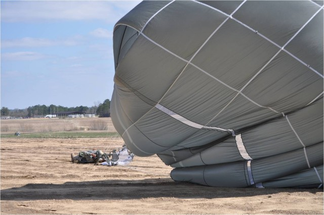 A paratrooper using the T-11 parachute lands March 16 at Fryar Drop Zone on Fort Benning, Ga. The 52-pound T-11 reduces a paratrooper's landing impact by 49 percent, which is expected to significantly reduce jump-related injuries.