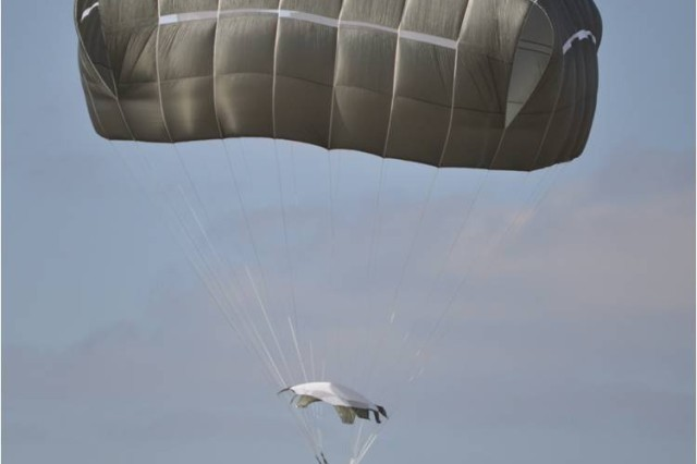A paratrooper using the Army's new T-11 parachute comes in for his landing March 16 at Fryar Drop Zone on Fort Benning, Ga. The T-11 is designed for the modern warfighter whose average combat load has increased to more than 400 pounds compared to earlier loads of about 300 pounds.