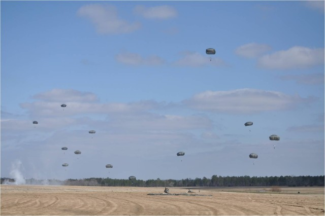 Paratroopers float to the ground at Fryar Drop Zone on Fort Benning, Ga., March 16 using the Army's new T-11 parachute. More than 400 students made the jump with the parachute that is replacing the T-10, which has been in the Army's inventory since the 1950s.