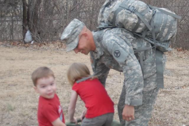 Maj. Brian Chapuran and his children retrieved his duffle bags.  (U.S. Army photo by Robert Stevenson)