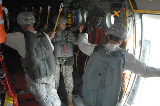 CSM Chippy Mezzaline, 1st Battalion (Airborne), 507th Parachute Infantry Regiment, prepares to jump with the new T-11 parachute March 16 at Fryar Field on Fort Benning, Ga.