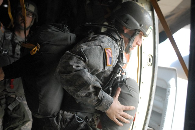 An Airborne student exits with the T-11 parachute.