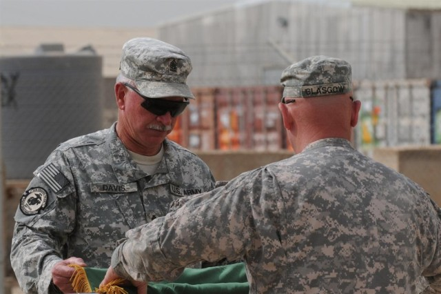 Command Sgt. Maj. Glen Davis, the senior enlisted adviser with the 155th Heavy Brigade Combat Team, 13th Sustainment Command (Expeditionary) and a Fulton, Miss., native, and Col. William L. Glasgow, the commander of the 155th and a Brookhaven, Miss., native, case the brigade's colors, signifying the end of their deployment, during a transfer of authority ceremony March 12 at Contingency Operating Base Taji, Iraq. The 278th Armored Cavalry Regiment, 13th ESC out of Knoxville, Tenn, replaced the 155th HBCT.