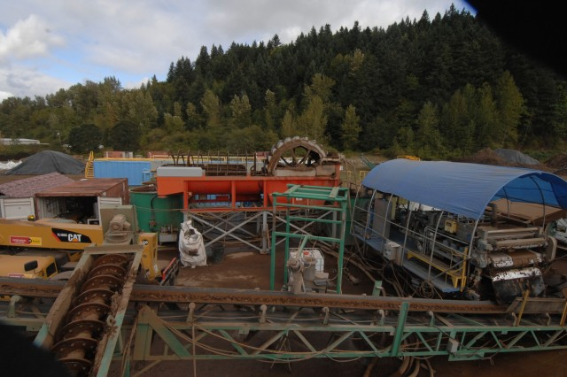 The multi-stage soil treatment process included a closed-loop water treatment system, allowing all process water to be reused. The soil slurry discharged from the gravity separation process was directed to the water treatment plant to remove solids, which were recombined on the central conveyor. At project completion, the remaining water was treated with a sand filter and granulated activated carbon for reuse as irrigation water on newly planted native vegetation.