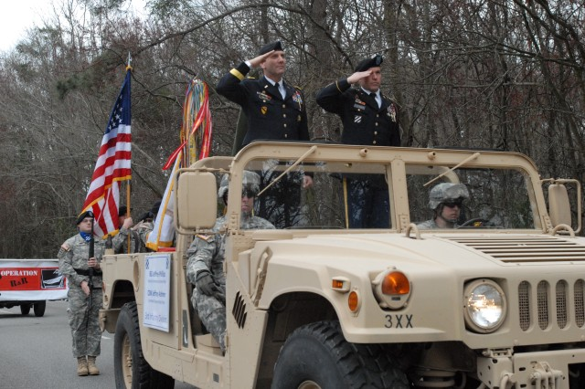 Brigadier General Jeffrey Phillips, 3rd ID deputy commanding general-rear and Command Sgt. Maj. Jeffrey Ashmen, 3rd ID deputy command sergeant major-rear, render honors as the National Anthem plays at the 27th annual Hilton Head Island, S.C., St. Patrick's Day Parade, March 14.