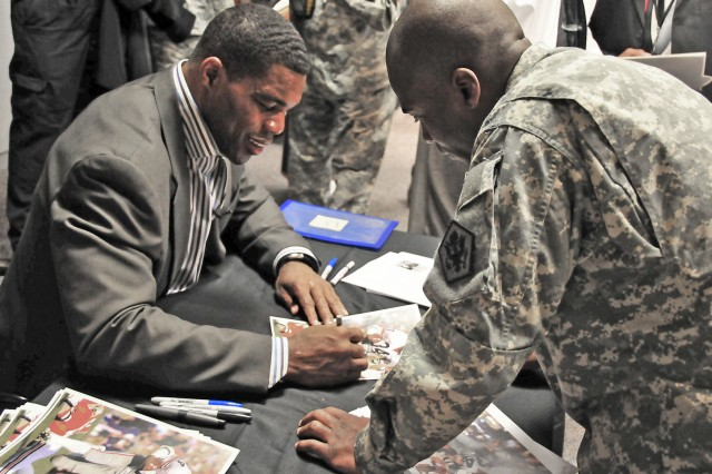 Herschel Walker signs autographs at the Army National Guard Readiness Center in Arlington, Va., March 18 after speaking about how to recognize and overcome mental health challenges.