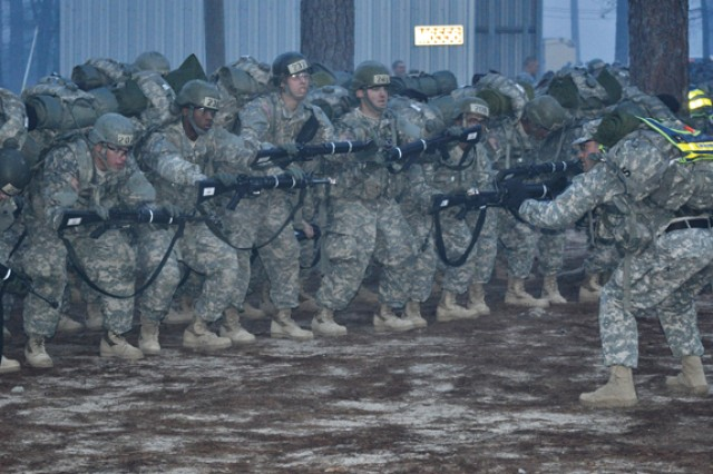 SFC Jeffrey Althouse leads 2nd Platoon in stretching exercises after the company completed an 8-kilometer ruck march the morning of March 9.