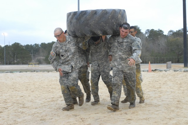 SFC Danny Chappell, left, and CPT Shane Smith lead A Company in the Tire Carry event Friday during the CSM Physical Fitness Challenge.