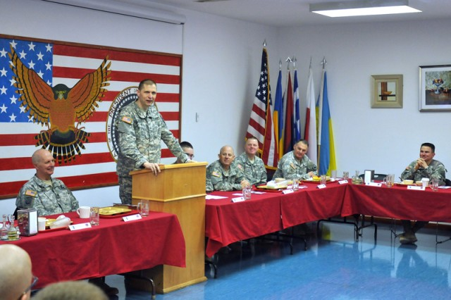 Brig. Gen. Al. Dohrmann, commanding general of Kosovo Forces 12, Multi-National Battle Group-East, speaks to Soldiers under his command during a prayer breakfast held recently at Camp Bondsteel, Kosovo. The prayer breakfast featured U.S. Army Europe Command Chaplain (Col.) Charles R. Bailey and focused on how Soldiers persevere through deployments.