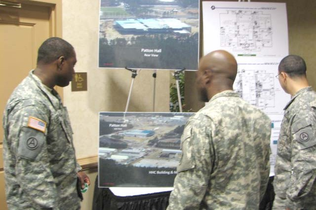 Soldiers from Third Army/U.S. Army Central (Third Army) look at photos and illustrations of their new headquarters building at Shaw Air Force Base during the Sumter Strategic Relocation Expo held March 17 at The Commons at Fort McPherson. The expo brought businesses, schools and recreation facilities from the city of Sumter, S.C., to Fort McPherson to show Soldiers, Family members and Civilian employees relocating to Shaw Air Force Base the community they will be moving to in 2011 after Fort McPherson and Fort Gillem close based on the Base Realignment and Closure Act.