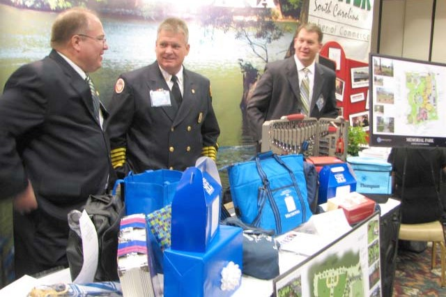 Several prominent Sumter city officials, including (left to right) Nick Shorter, city administrative director, Karl Ford, city fire chief, and Deron McCormick, city manager, were on hand to talk with Third Army Soldiers, Family members and Civilian employees. Besides information, the businesses also provided gifts that attendees could win.