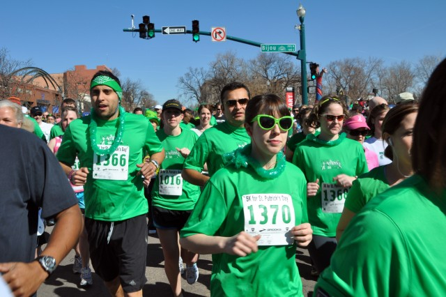 """COLORADO SPRINGS, Colo.-Many of the 1,900 participants in Colorado Springs' St. Patrick's Day 5K Race show off their """"traditional"""" green. T-shirts were sent to the Soldiers in Afghanistan who ran the Jalalabad Jig, a sister race."""