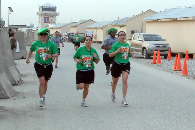 "FOB FENTY, Afghanistan-Three Soldiers are ""wearing the green"" in the Jalalabad Jig, a sister race to Colorado Springs' St. Patrick's Day 5K Run, on March 13."