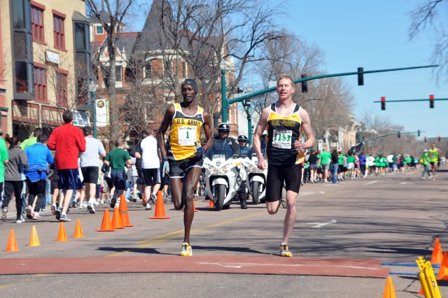 COLORADO SPRINGS, Colo.-From left, Spc. Robert Cheseret and 1st Lt. John Mickowski sprint to the finish line in the 5K St. Patrick's Day 5K Race March 13, finishing first and second respectively. Both men are stationed at Fort Carson with the World Class Athlete Program.