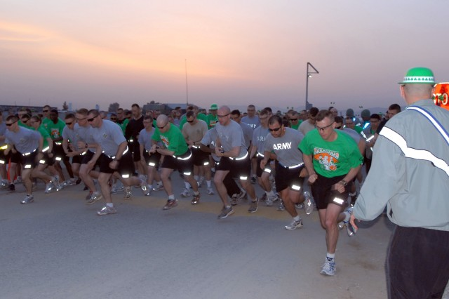 FOB FENTY, Afghanistan-Servicemembers and civilians serving under Task Force Mountain Warrior sprint from the starting line to begin running the three-and-a-half mile race in honor of St. Patrick\'s Day on Forward Operating Base Fenty in eastern Afghanistan's Nangarhar Province March 13. The Jalalabad Jig was run as a sister race to Colorado Springs' St. Patrick's Day Race.