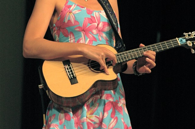 HONOLULU - Ukulele virtuoso Taimane Gardner strikes a statuesque pose while performing on the Festival Stage, Hawaii Convention Center, during the 16th annual Honolulu Festival, March 13.