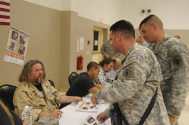 """Cast members of the FX show """"Sons of Anarchy"""" sign autographs for service members during a meet and greet March 16 at Joint Base Balad, Iraq"""