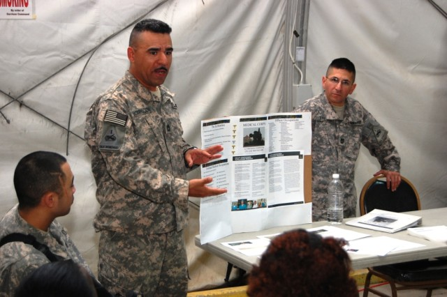 Sgt. 1st Class Julion Encarnacion from Selma, Texas and Capt. Luis Trevino, battalion physician assigned to 121st Brigade Support Battalion, speak to Soldiers about careers in the Army medical field.