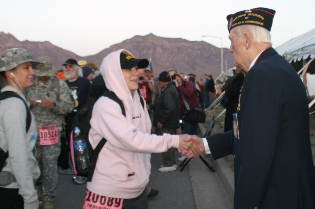"""A marcher stops to thank Bataan Death March survivor William """"Bill"""" Eldridge at the start line of the 21st annual Bataan Memorial Death March at White Sands Missile Range, N.M., March 21. A record-breaking 5,700 marchers participated in this year's event."""