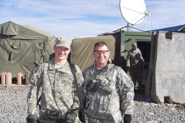 BAGRAM AIRFIELD, Afghanistan - U.S. Army Col. R.D. Hooker Jr., a Paratrooper since 1981, leads the communications action group of Combined Joint Task Force - 82, at Bagram Airfield, Afghanistan, and U.S. Army Pvt. Chris Hooker graduated jump school in 2009 and is currently serving at a command outpost in eastern Afghanistan. Col. Hooker Jr., and Pvt. Chris Hooker are part of a family of paratroopers spanning three generations. (Courtesy photo)