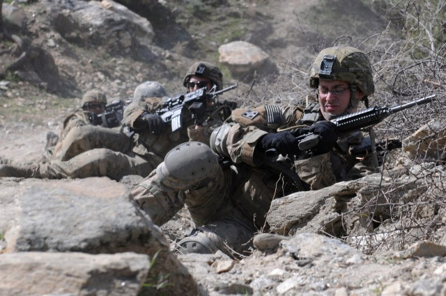 KUNAR PROVINCE, Afghanistan - U.S. Army 2nd Lt. Robert J. De Young, of Atlanta, Ga., the incoming platoon leader of 2nd Platoon, Company D, 2nd Battalion, 12th infantry Regiment, Task Force Lethal, reloads during an attack by insurgent forces in the Tantil Village in eastern Afghanistan's Kunar province, March 13. Afghan National Security Forces and International Security Assistance Forces visited the community and its elders because of a high number of recent militant attacks in the area. No ANSF or ISAF members were wounded during the small arms attack. (Photo by U.S. Army Staff Sgt. Gary A. Witte, 300th Mobile Public Affairs Detachment)