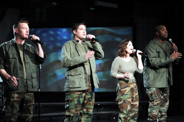 4TROOPS vocalists Daniel Jens, David Clemo, Meredith Melcher and Ron Henry perform aboard the USS Intrepid in New York City during the March 15 taping of a PBS television special to be aired in June.