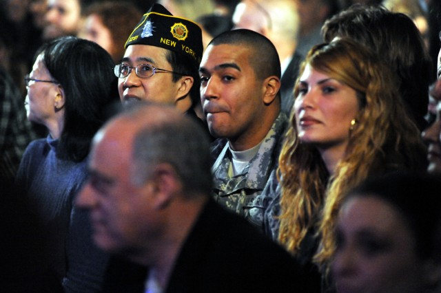 Soldiers and veterans are scattered throughout the audience at the March 15 taping of a 4TROOPS concert aboard the USS Intrepid in New York City. The show will air on PBS television in June.
