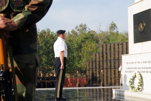 Lt. Gen. Benjamin R. Mixon, commanding general, U.S. Army, Pacific, stands at attention to honor those who have fallen in battle at a war memorial at the Indian Army Western Command Headquarters.