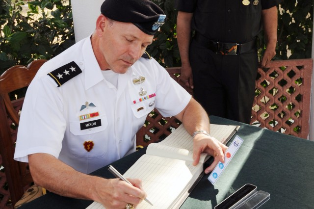 Lt. Gen. Benjamin R. Mixon signs a guest registry at the war memorial at the Indian Army Western Command Headquarters in Chandigahr, India, March 22.