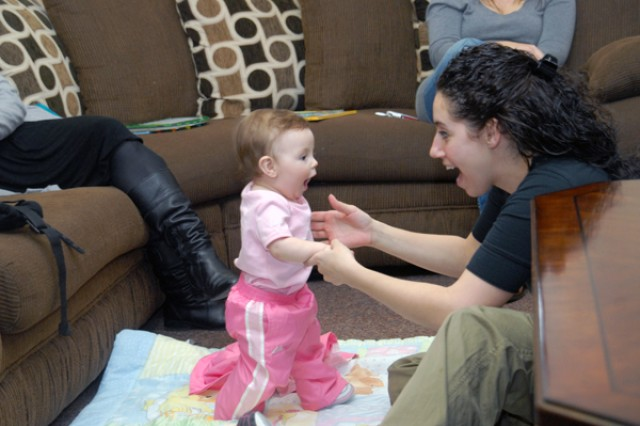 Nicole Darak, member of Pear Blossom Cottage, playfully smiles with her daughter during a parenting meeting March 16.