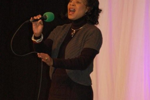 Lyra Kramer, volunteer at USAG Schinnen, entertains during the recent Black History Celebration. Sharing her gift of music is just one of the ways she volunteers in the Tri-Border area.